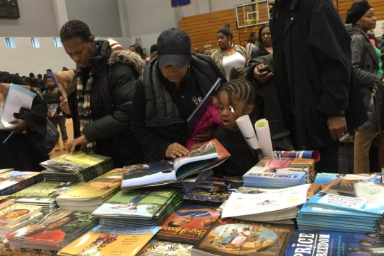 People looking at books